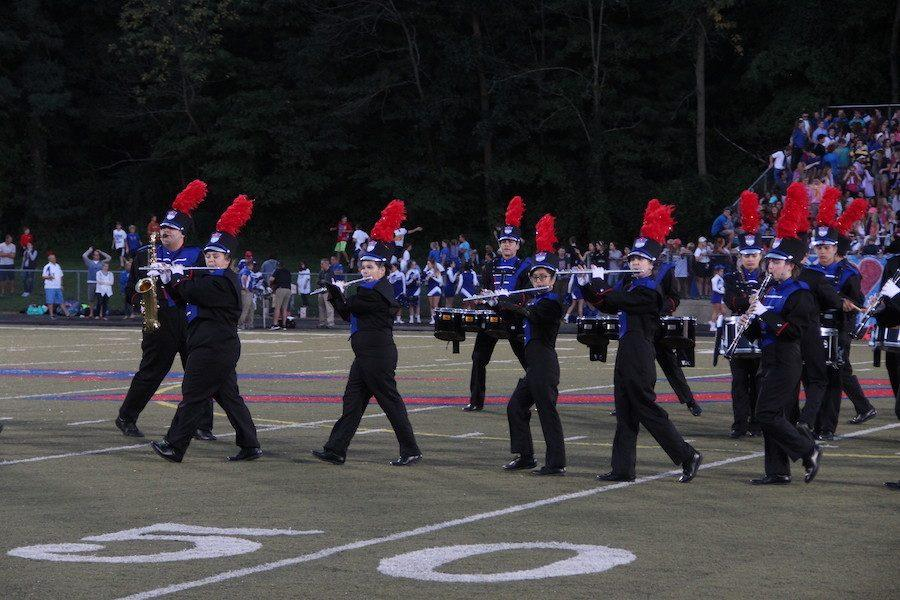 MARCH+TO+THE+BEAT%3A+The+Rebel+Marching+Band+performing+at+the+Roncalli+v.s.+Bishop+Chatard+game.+The+band+performs+weekly+at+halftimes+of+football+games.