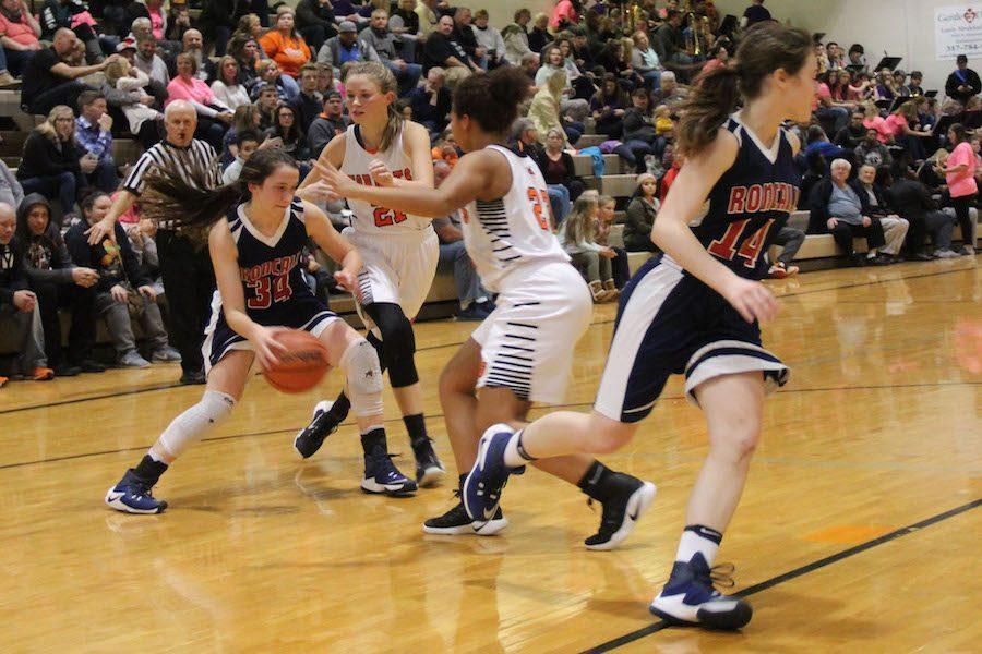 DRIVE+TO+WIN%3A+Sophomore+Maggie+Schoening+dribbles+around+defenders+from+Beech+Grove.+Although+it+was+a+hard+fight%2C+the+Lady+Rebels+fell+to+the+Hornets+62-42.