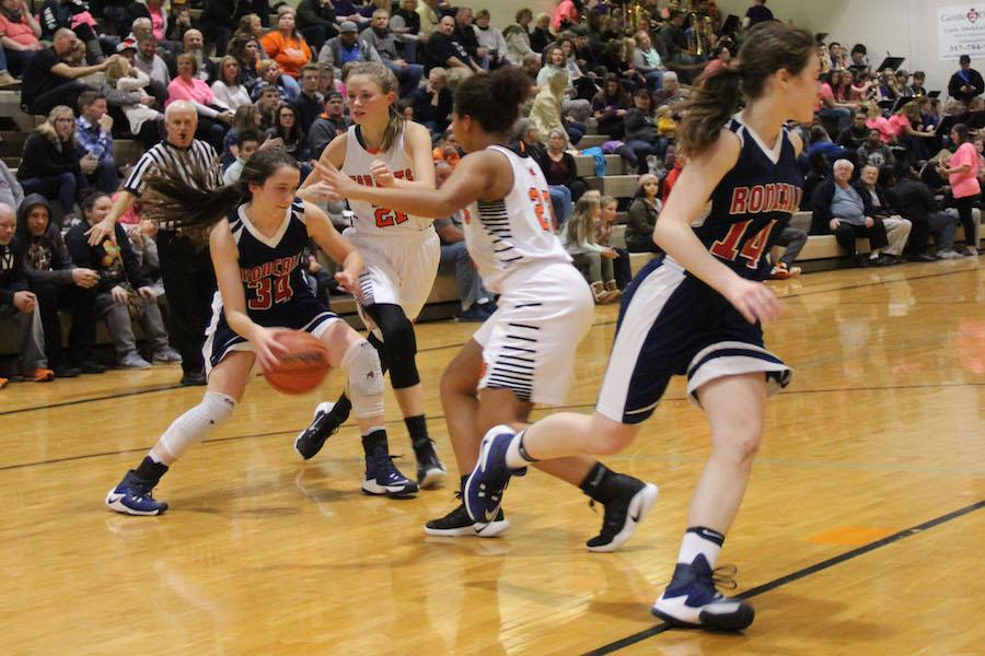 DRIVE TO WIN: Sophomore Maggie Schoening dribbles around defenders from Beech Grove. Although it was a hard fight, the Lady Rebels fell to the Hornets 62-42.