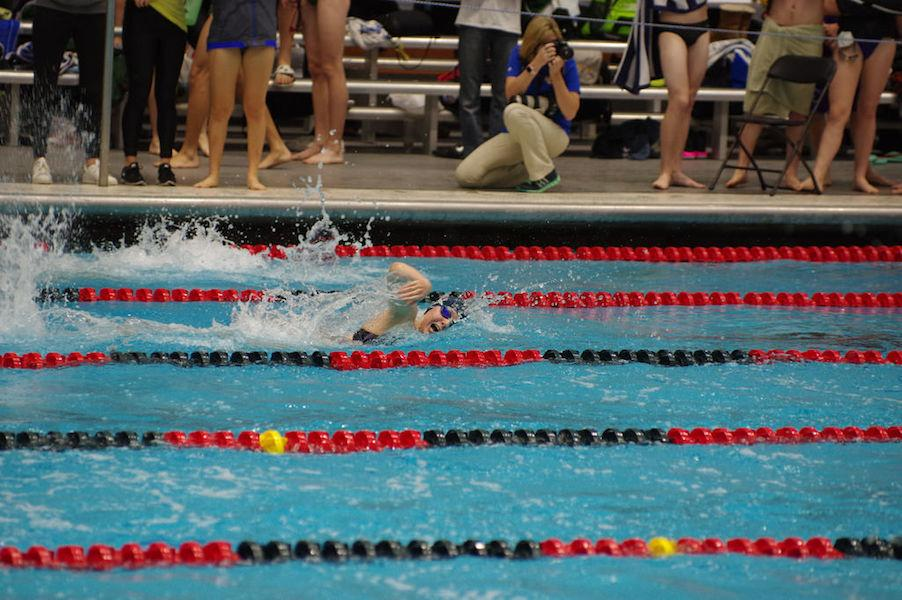 MAKING BUBBLES: Senior Ashley Harter swimming the last lap of the 200 medley relay at the Holiday Invite in December. The Lady Rebels took home 6th at this meet.