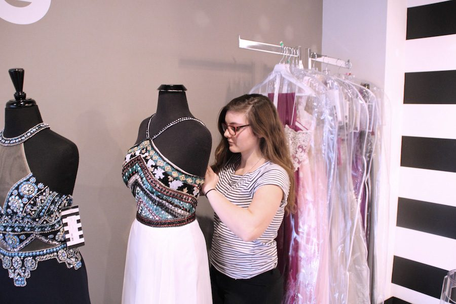 PROM+EXPERTISE%3A+Senior+Ally+Pence+works+at+Sophia%27s+Bridal+Tux+%26+Prom.++Pence+has+spent+a+good+amount+of+time+with+eager+customers%2C+making+her+an+expert+in+fashion+expertise+for+the+upcoming+prom+season.
