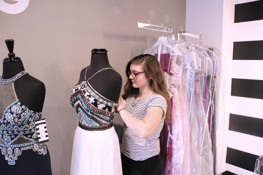 PROM EXPERTISE: Senior Ally Pence works at Sophia's Bridal Tux & Prom.  Pence has spent a good amount of time with eager customers, making her an expert in fashion expertise for the upcoming prom season.