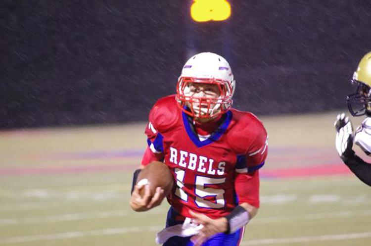 Quarterback Cam Smock ran for a touchdown in last year's win over Decatur Central. The Rebels look to win again against the Hawks this week.
