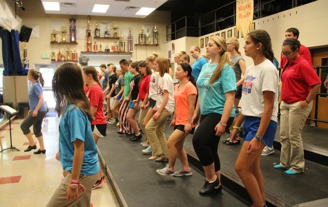Students attend a tap dancing lessons before trying out for the musical
