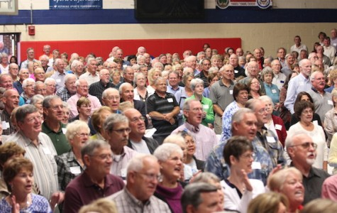 """Pep rally for God: Hundreds of grandparents gather together in the Family Room to celebrate mass. After mass, the grandparents joined the students in a """"Pep Rally for God""""."""
