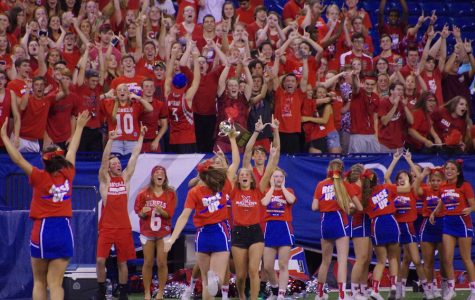 CELEBRATE THE VICTORY: Rebel fans celebrate the Chick-fil-A Challenge victory. The winner was announced at Lucas Oil Stadium during halftime of the football game against Franklin Central.