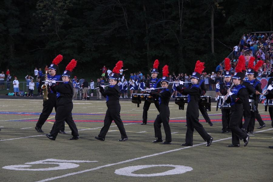 MARCH TO THE BEAT: The Rebel Marching Band performing at the Roncalli v.s. Bishop Chatard game. The band performs weekly at halftimes of football games.