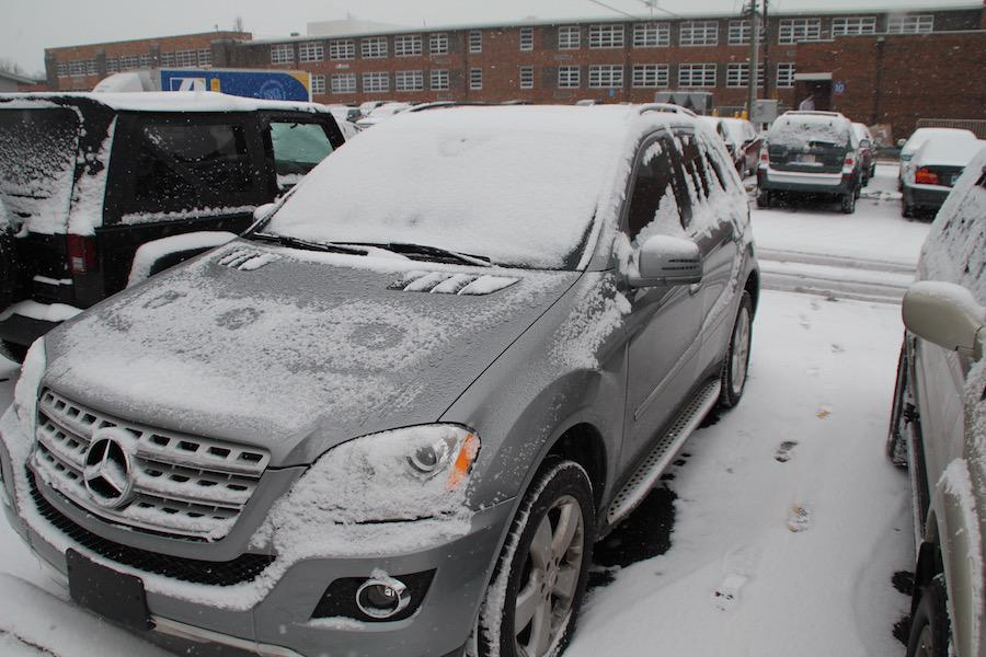 BLUSTERY WEATHER: Student car in the parking covered with snow. There are many precautions to take before driving in the cold and snowy weather.