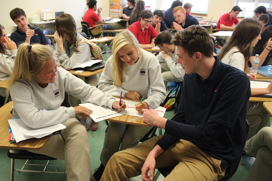 FOCUSED: Seniors Katie Griffin, Maddie Ganka, and Jackson McHugh work together on a math project. Along with keeping grades up, all three balance jobs and other activities as well.