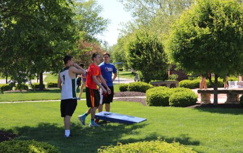 IN IT TO WIN IT: Seniors Alex Kuntz, Sammy Matis, and Will English participate in a corn hole tournament at the StuCo Extravaganza. While more people have participated this year than last, it is still less than the 30-40 teams from five years ago.