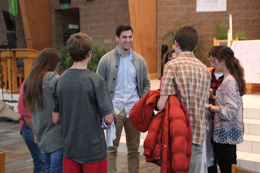 COUNTING DOWN: As the departure date for NCYC nears, youth minister at St. Jude Sean Hussey discusses some last minutes plans with a group of students. NCYC will take place in Lucas Oil Stadium this weekend.