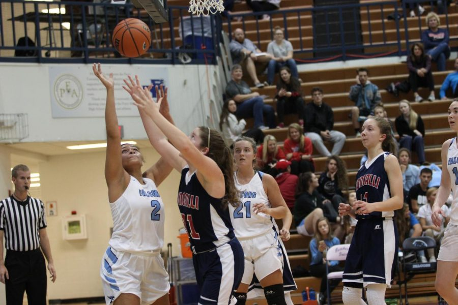 REBEL+REBOUND%3A+Senior+Katelyn+McClary+extends+her+arms+for+a+quick+rebound+over+Perry+Meridian+star+Sadie+Hill.+The+Lady+Rebels+won+the+game%2C+their+season+opener%2C+over+the+Falcons+60-35.