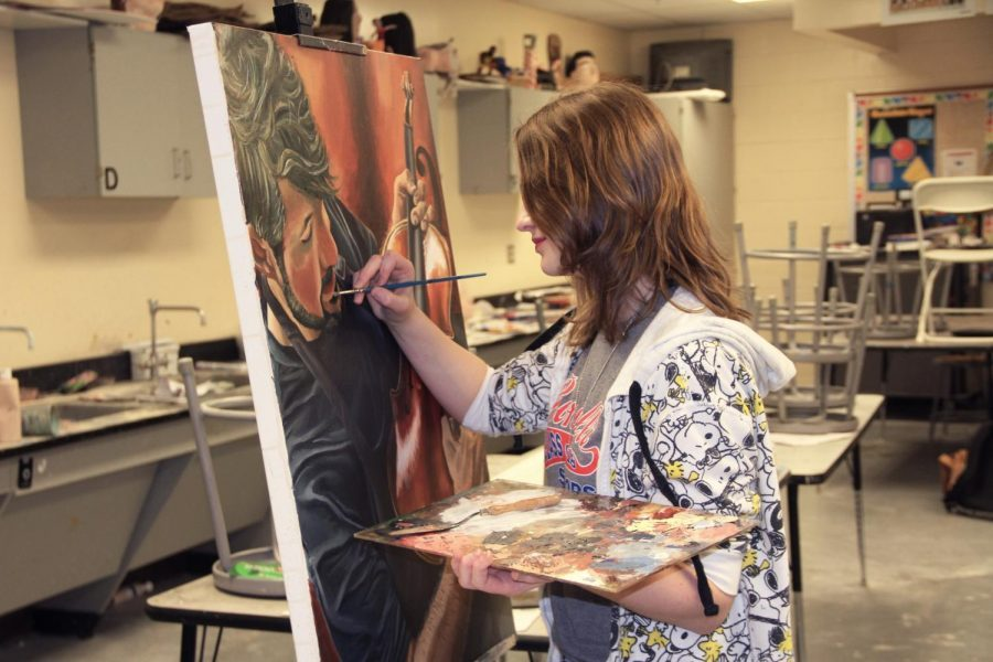 PICTURE THIS: Pictured above is one of senior Rachel Knierman's most recent paintings portraying a violinist. This painting is to be used in an upcoming violin competition.