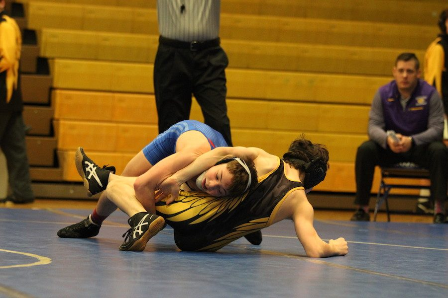 TAKING+DOWN+CONFERENCE%3A+Sophomore+Brayden+Lowery+takes+down+Guerin+Catholic+wrestler+Jon+Koscal+to+advance+further+in+the+Circle+City+Conference+Meet.+Lowery+later+ended+up+winning+his+conference.+
