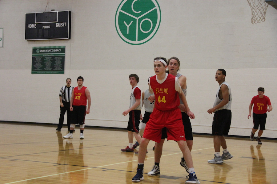 HEAD IN THE GAME: Senior Shane Sanneman guards his opponent at his team's game against St. Christopher. His St. Jude team lost this game which ended their run at city.