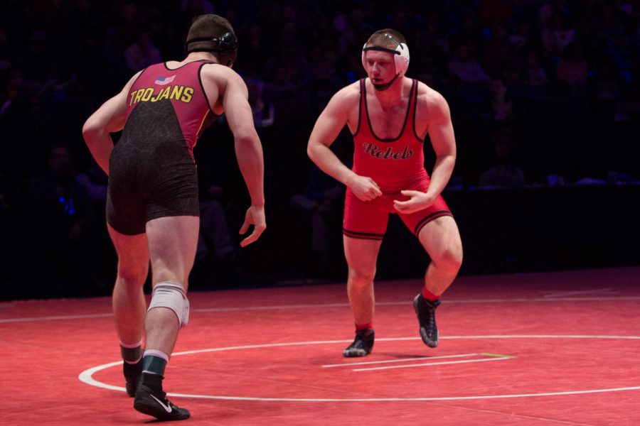 SIZING UP THE COMPETITION: Senior Sam Hansen prepares to wrestle his competitor, senior Lucas Davison from Chesterton High School. Hansen finished as state runner-up in the 195-pound weight class, the highest rank of anyone who competed from Roncalli this year.