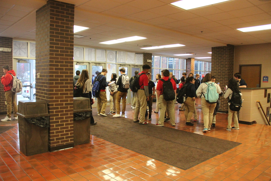 GATHERING PLACE: Rebels congregate in the lobby after an early dismissal. Many students, especially underclassmen, find themselves stuck at Roncalli without rides hours after the final bell.