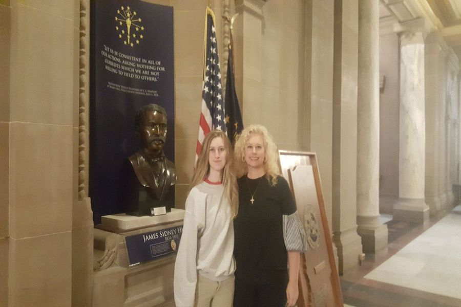 SIDE BY SIDE: Sophomore Paige Moore and her mother, who went to testify as a parent and give moral support, pose in the Indiana Statehouse. Moore said without her mom by her side, she would have been much more nervous during the trial.