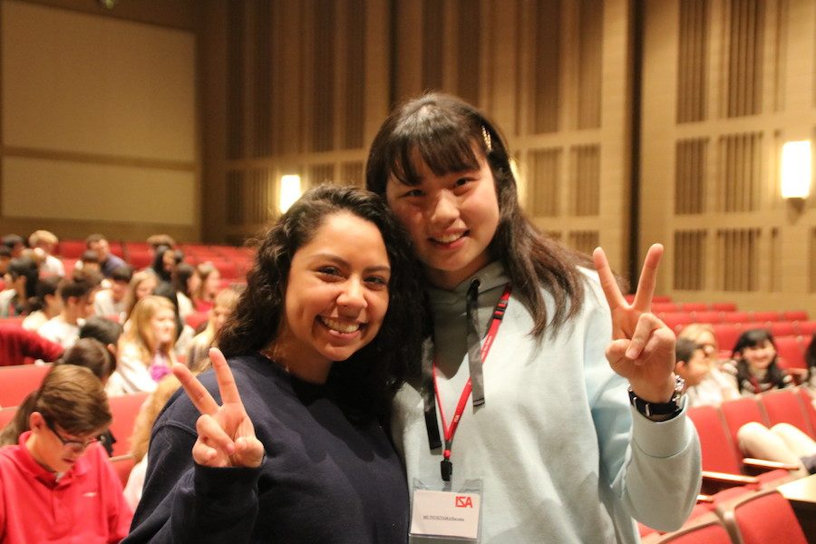 PEACE+OUT%3A+Junior+Beatriz+Venegas+and+her+shadow+Sayaka+Tsukiyama+pose+with+peace+signs+for+a+photo.+The+two+girls+spent+the+day+sharing+laughs+before+saying+their+goodbyes+at+the+end+of+the+school+day.