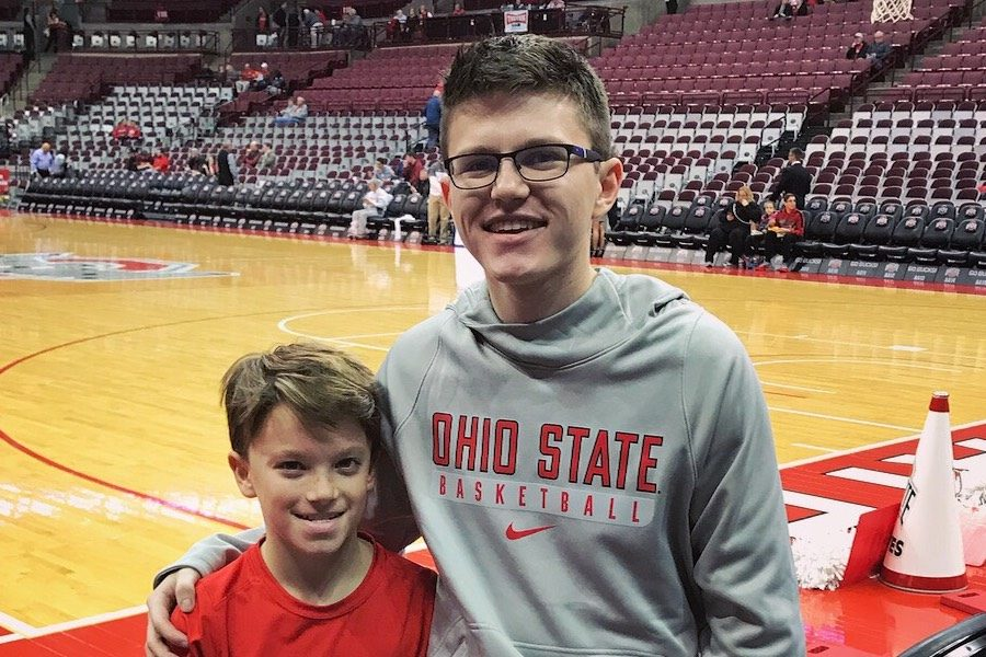 BUCKEYE+FOR+A+DAY%3A+Tyler+Hicks+%28right%29+visits+The+Ohio+State+University+during+a+home+game+and+sits+front+row%2C+courtesy+of+assistant+coach+Mike+Schrage.+He+invited+Hicks+in+hopes+that+Hicks+would+decide+to+spend+his+next+four+years+there.