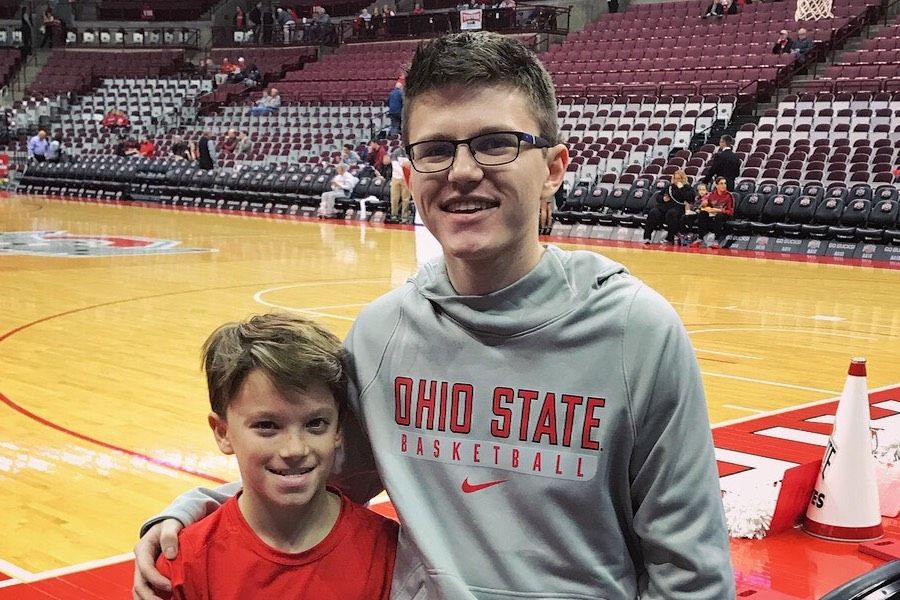 BUCKEYE FOR A DAY: Tyler Hicks (right) visits The Ohio State University during a home game and sits front row, courtesy of assistant coach Mike Schrage. He invited Hicks in hopes that Hicks would decide to spend his next four years there.