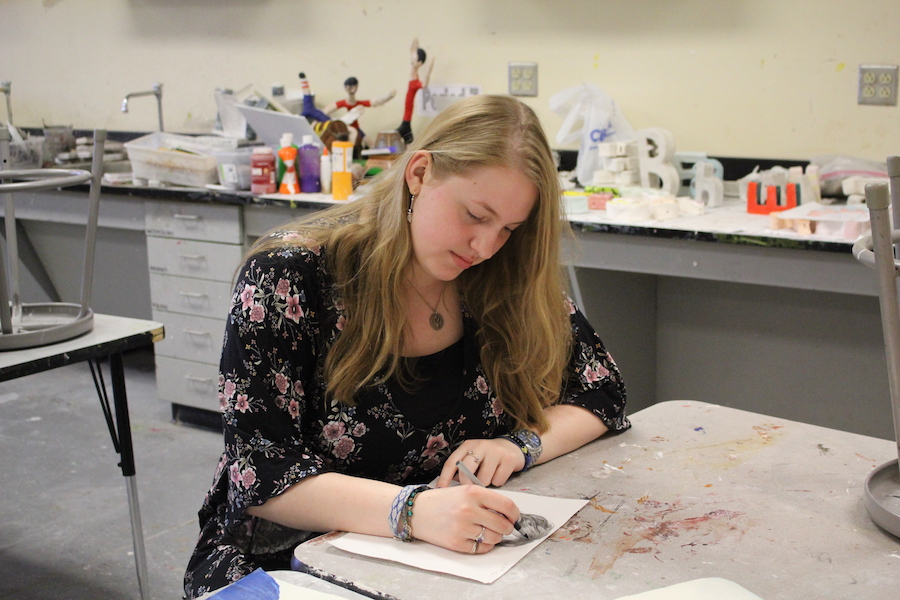 Senior Kathryn Witsaman sketches a picture of hair for her AP Studio Art class. Witsaman has been doing art since she was in grade school, but started to take it much more seriously in high school.