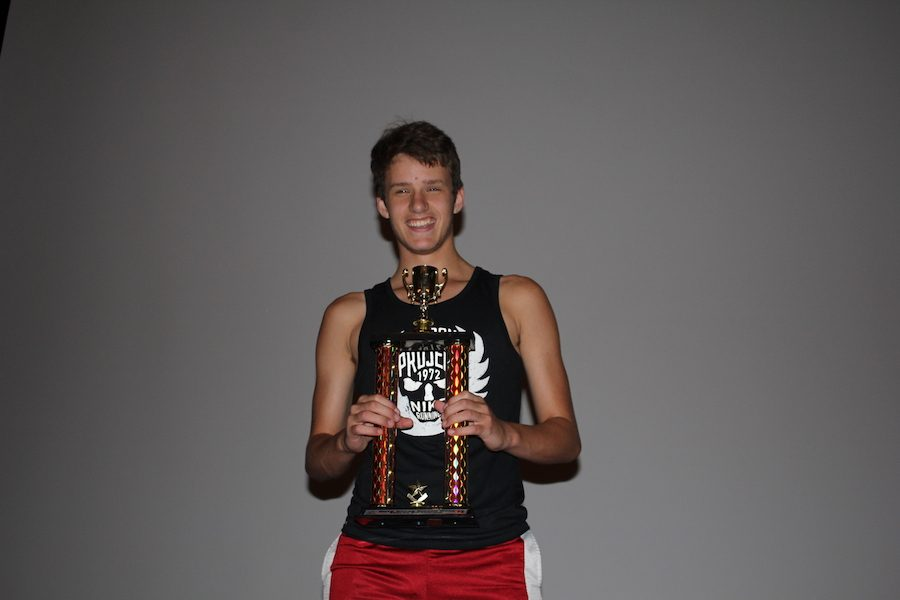 HUMBLE+CHAMP%3A+Junior+Gabe+Buening+poses+with+his+trophy+in+celebration+of+his+victory.+Buening+took+home+first+place+in+the+Melee+bracket+of+the+tournament.