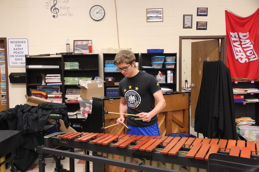 PRACTICE+MAKES+PERFECT%3A+Senior+Luke+Dow+practices+his+piece+on+the+marimba.+This+is+one+of+the+three+instruments+that+Dow+performed+on+at+the+2018+ISSMA+State+competition.