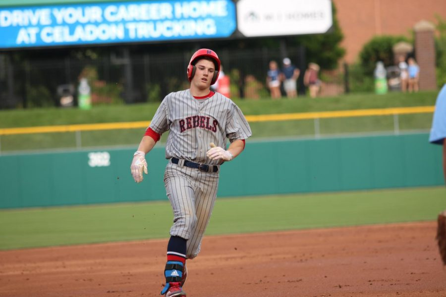 MAJOR LEAGUE HUSTLE: Senior Nick Schnell makes his way toward third base. The Rebels beat Perry Meridian 5-3 at Victory Field to crown themselves County Champions.