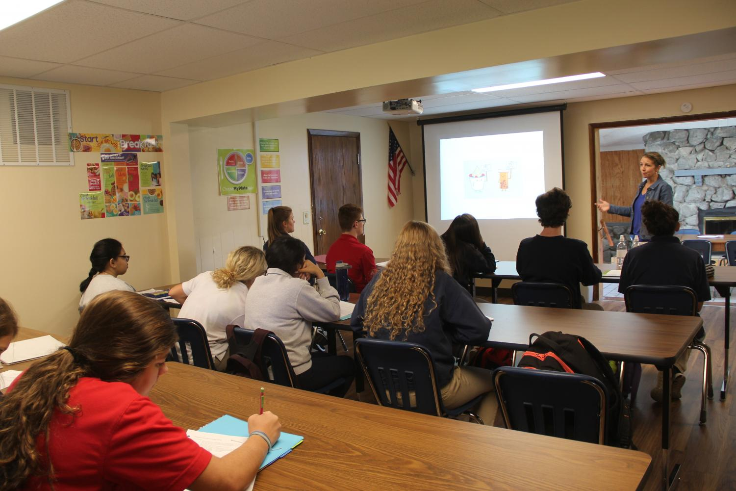 STUDYING STUDENTS: Students in fifth period take a seat to listen to Mrs. Smith explain the images on the projector. They will later turn in a study guide in preparation for their upcoming test.
