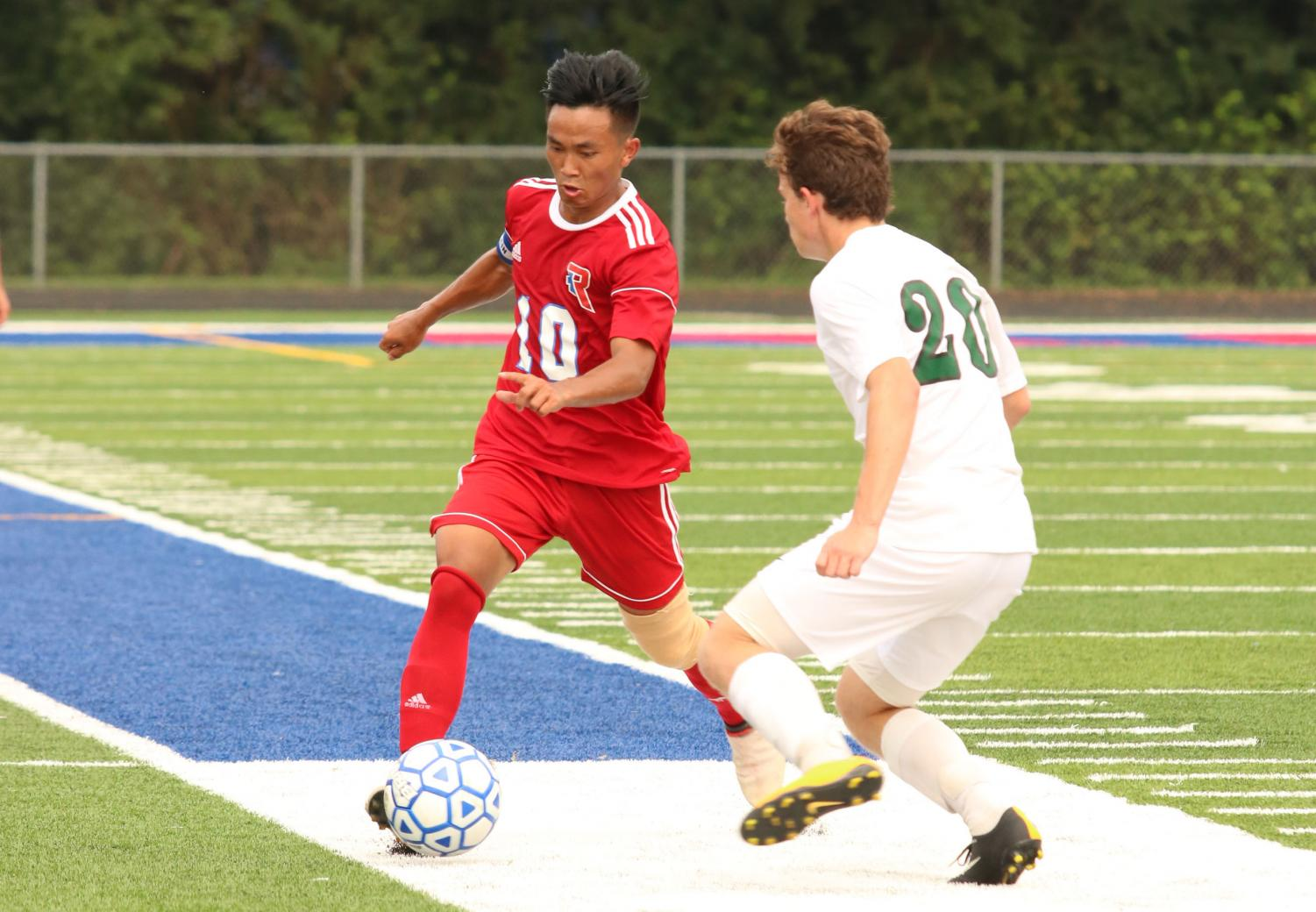 BRACE YOURSELVES: Robert Thang dribbles down the field in a game against Covenant Christian. Robert scored two goals for the Rebels and the team went on to win the game 4-1.