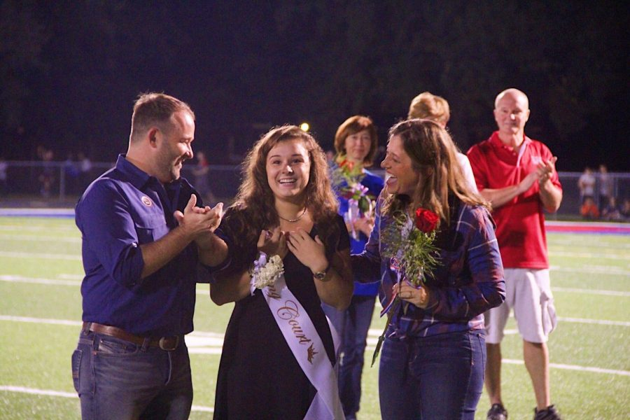 ROYAL+SMILES-+Sarah+Gantner+smiles+shockingly+as+she+hears+her+name+called+for+Homecoming+Queen.+Gantner+was+one+of+seven+senior+girls+eligible+for+the+crown.+