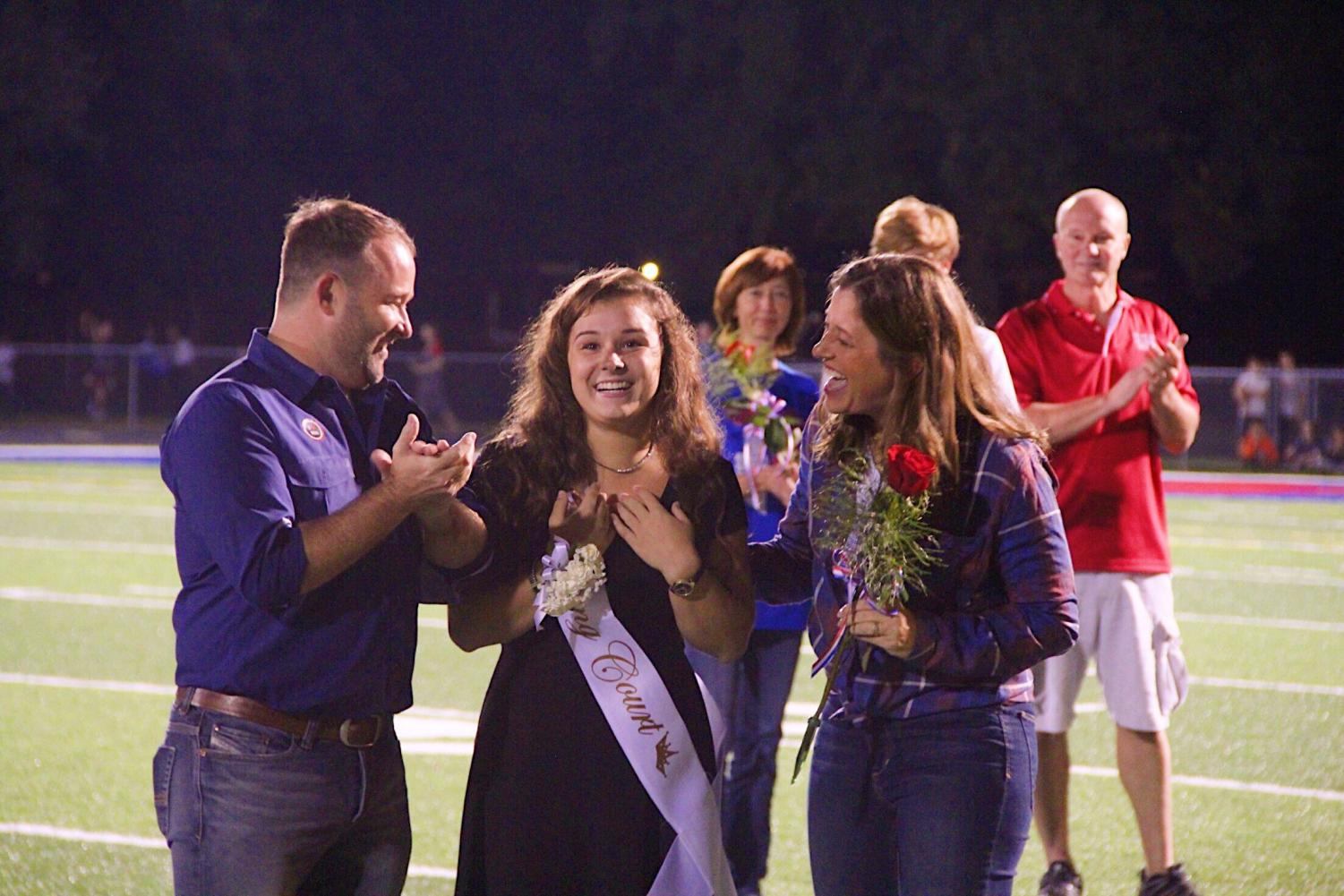 ROYAL SMILES- Sarah Gantner smiles shockingly as she hears her name called for Homecoming Queen. Gantner was one of seven senior girls eligible for the crown.