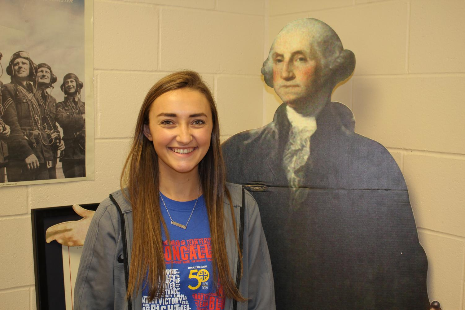 TRADITION OF EXCELLENCE: Maddie Mulinaro stands by her role model George Washington in her US History classroom. He was one of the first additions to her new classroom.