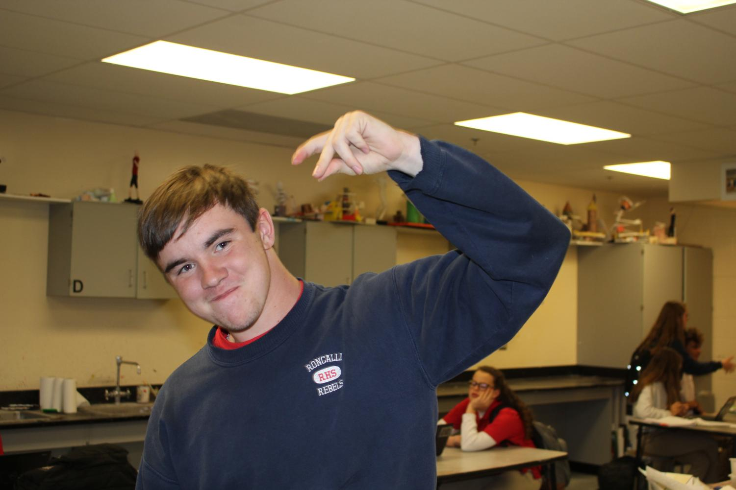 YOU NEED: Junior Andrew Beaver snaps at the camera. The snap has been apart of Roncalli's rich culture for five years.
