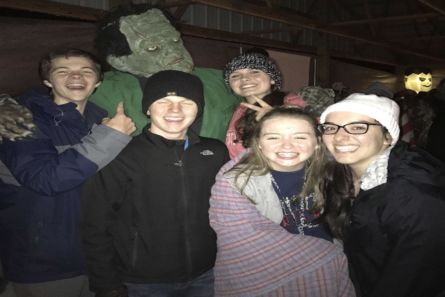 FRANKEN-PHOTO: Seniors Mia Roberts and Allie Pena, along with juniors Lilly Secrest, Levi Ralston, and Trey Kocher pose with a costumed Frankenstein at Sweetwater Lake. Roberts did not enjoy the feeling of fear in the moment, but reported the rush as a rewarding experience.