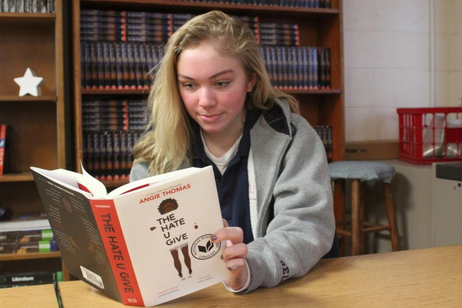 KEEP CALM AND READ ON: Senior Cassie Yohler reads The Hate U Give during her study period. Yohler has read the novel before, but is revisiting the text after recently seeing the movie.