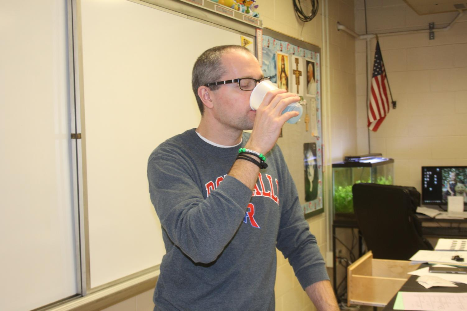 MMMM TASTY: Chemistry teacher Ben North drinks the remaining gulps of original Windex spray cleaner. North drinks approximately two gallons of the savory blue raspberry cleaner each week.