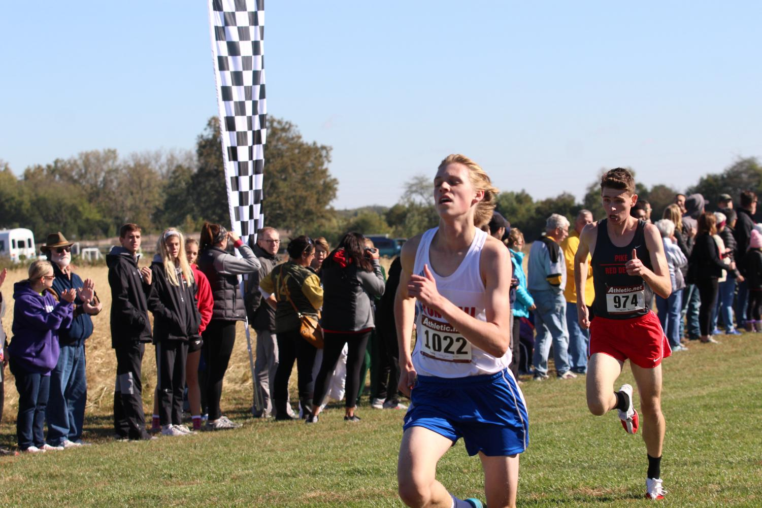 FINISHING STRONG: Senior Nick Perkins races towards the finish line in the semi-state meet. Perkins placed 3rd in semi-state with a time of 15:48.7, breaking his previous Roncalli record