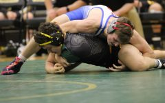 Season begins for Rebel wrestlers