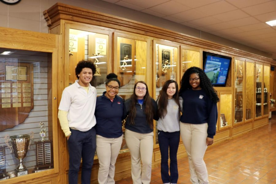 WE CARE: Seniors Elijah Mahan, Sarah Hayden, Chelsea Nguyen, and Nellie Nnatubuego and junior Angie Snow along with several other students are part of Roncalli's We CARE initiative. This group began with the goal of making Roncalli a more welcoming and comfortable environment for students of minority background.