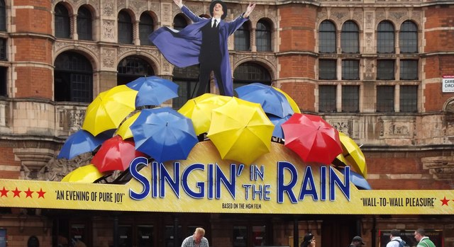 An+advertisement+for+the+London+performance+of+%22Singin%27+In+The+Rain%22+at+the+Palace+Theater+in+2012%0A