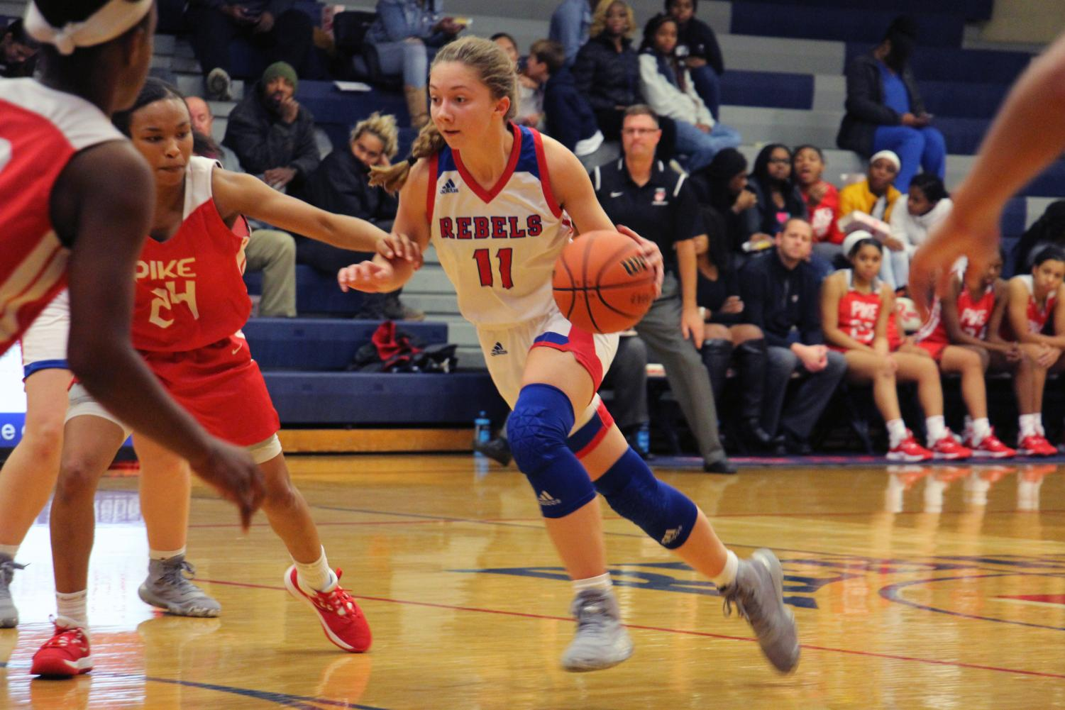 DRIVING IN THE PAINT:  Senior Alana Vinson dribbles the ball down the lane and finishes at the rim. Vinson completed the game with 21 points and nine rebounds.