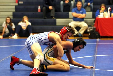ROAD TO VICTORY: Freshman Bryce Lowery wins by tech fall, 16-1, in his match against Baugh (Greenwood) in the varsity dual meet Dec. 5th.