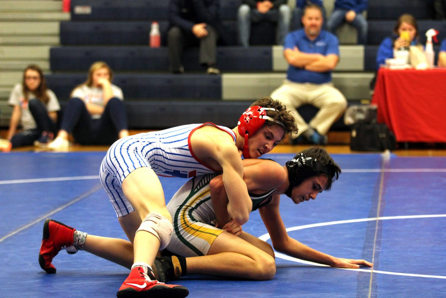 State-ranked wrestlers commence