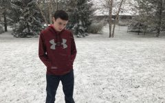 SADDENING SNOWFALL: Sophomore Ronan Euzen stares dejectedly at the ground, perhaps pondering the bleak scenario in which he is part of the last generation in Indiana that gets to experience snow. If climate change continues, this scenario could come to fruition.