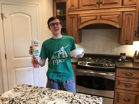 CEREAL SADNESS: Sophomore Ronan Euzen is overcome by utter depression as he prepares to eat cereal for the millionth time. Fortunately for him, quarantine presents him with the time to undertake the task of learning how to cook.