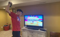 """LIGHTNING MCQUEEN'S BREAKFAST: Sophomore David """"Zesty Dave"""" Warner throws his controller in a fit of rage after being eliminated from a round of """"Fall Guys""""."""