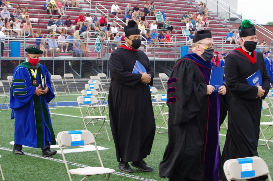 CELEBRATING+THE+FAITH%3A+Father+Robeson+preparing+to+say+mass+at+graduation+for+the+class+of+2020.+Graduation+was+held+on+July+21st+at+the+Roncalli+stadium.
