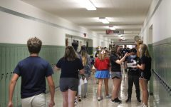 Freshman walk to their first period class. They receive help from seniors on where to go and will be greeted at their classroom by more students.